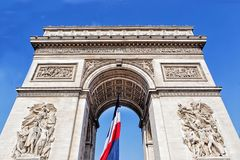 Arch of triumph with french flag in Paris, France Stock Photo