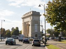 The Arch Of Triumph - 26m granite arch built in memory of WWI troops, with internal stairs for city views on the Arc de Triomphe S. Bucharest, Romania, October Stock Photography