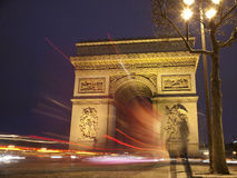 Arch of Triumph (Paris,France). Beautifully lit Triumph Arch at night with light traces of passing cars. Paris, France Royalty Free Stock Images