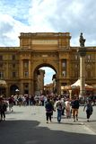 Arch of Triumph in Florence - Italy. Arch of Triumph on the Piazza della Repubblica in the historic center of Florence with peoples - Italy Stock Photos