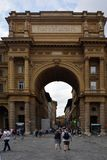Arch of Triumph in Florence - Italy. Arch of Triumph on the Piazza della Repubblica in the historic center of Florence with peoples - Italy Stock Photography