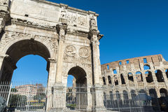 Arch of triumph in Rome, Italy. Arch of triumph known as Arch of Constantine with the coliseum in the background in Rome, Italy Royalty Free Stock Image