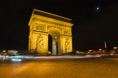 Arch of Triumph of the Star (Arc de Triomphe de l'Étoile) in Paris (France). At night Royalty Free Stock Photos