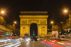 Arch of Triumph of the Star (Arc de Triomphe de l'Etoile) in Paris (France). At night Stock Photo