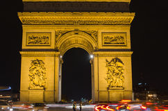 Arch of Triumph of the Star (Arc de Triomphe de l'Etoile) in Paris (France). At night Royalty Free Stock Photos