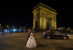 Arch of Triumph of the Star (Arc de Triomphe). Paris, France. PARIS - SEPT 16, 2014: Wedding couple near the Arch of Triumph of the Star (The Arc de Triomphe de Stock Images
