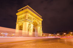 Arch of Triumph of the Star in Paris (France) at night Stock Images