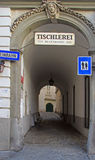 Arch tunnel with interesting sculpture in Vienna Royalty Free Stock Images