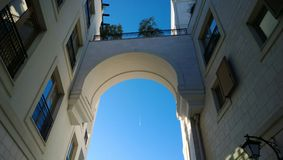 The arch between the two modern buildings in the city of Tivat, in Montenegro.  Royalty Free Stock Images