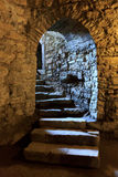 Arch in underground castle Stock Images