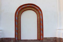 Arch in the wall. White walls decorated with multicolored arch with patterns Royalty Free Stock Image