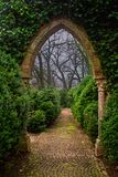 Enchanted door. The arch way for a fairy place, between spring and winter royalty free stock images