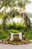 Arch for the wedding ceremony. Arch, decorated with beautiful fresh flowers and cloth. royalty free stock images