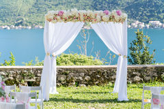 Arch for the wedding ceremony, decorated with cloth and flowers Royalty Free Stock Photography