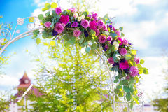 Arch for the wedding ceremony. Floristic composition in vintage Royalty Free Stock Image