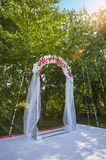 Arch for the wedding ceremony. Floristic composition Stock Photography