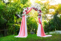 Arch for the wedding ceremony in the tropical garden. Floristic Royalty Free Stock Photo
