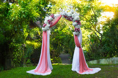 Arch for the wedding ceremony in the tropical garden. Floristic Royalty Free Stock Images