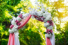 Arch for the wedding ceremony in the tropical garden. Floristic. Composition in pink Royalty Free Stock Photo