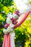 Arch for the wedding ceremony in the tropical garden. Floristic. Composition in pink Stock Images