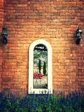 Arch window on brick wall Stock Photo