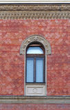 Arch window. At classic style building with red facade Royalty Free Stock Photography