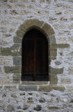 Arch window of medieval castle. Arch window in old stone wall of medieval castle Royalty Free Stock Images