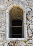 Arch window in old stone wall of medieval castle, vertical image. Arch window in old stone wall of medieval castle, horizontal image with copy space Royalty Free Stock Photos