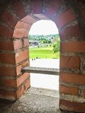 Arch window overlooking the courtyard. Of the castle Stock Photography