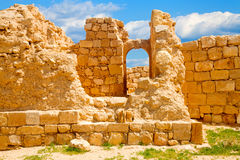 Arch window in ruined wall. Remnants of an stone arch window in the ruined city of Mamshit, Israel Royalty Free Stock Photos