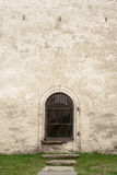 Arch with window. In stucco wall of old church Stock Photos