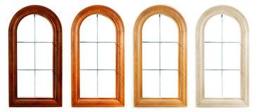 Arch windows. Round top windows in light and dark woods Stock Photography