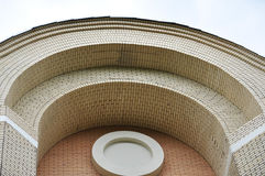 Arch of yellow bricks. And a concrete circle in the center Royalty Free Stock Image