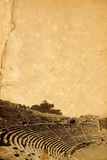 Archaeological background. Scan of old torn paper and image of ancient amphitheater in Patara, Turkey stock illustration