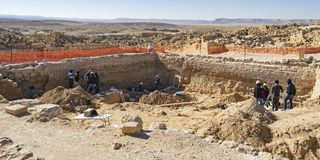 Archaeological Dig at Shivta National Park in Israel. An archaeological dig at shivta national park in israel showing archaeologists and workers excavating the royalty free stock photos