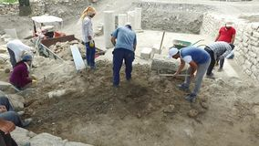 Archaeological excavation in sunny day. Excavation team doing archaeological excavations stock video