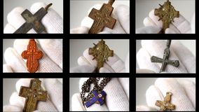 Archaeological find Christian pectoral cross close-up in hands with white gloves. Crucifix archaeological find. Multicam split screen group video wall collage stock footage