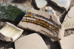 Archaeological finds - shards of ancient pottery. Vessels Stock Images