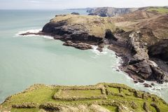 Archaeological foundations at Tintagel and Tintagel caves, Cornwall, Uk. Royalty Free Stock Images