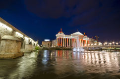 Archaeological museum of Macedonia at night. Beautiful old stone bridge and archaeological museum of Macedonia on star sky and moon Stock Photography