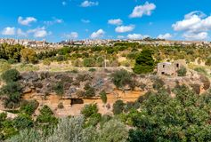 Archaeological Park of the Valley of the Temples in Agrigento, Sicily. Archaeological Park of the Valley of the Temples in Agrigento with Agrigento town in royalty free stock images