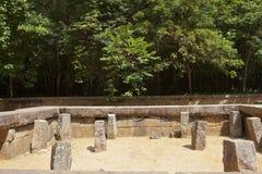Ritigala forest monastry in sri lanka. Archaeological remains at ritigala forest monastry in sri lanka with mature trees Royalty Free Stock Photography