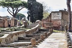 Archaeological Roman empire street view in Ostia Antica. Rome - Italy royalty free stock photo
