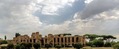 Archaeological ruins of the Severian Arcades on the Palatine wit. H a sky with many clouds. View from the street called `Viale Aventino` in Rome, Italy Stock Images