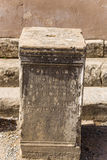 Archaeological site of Ephesus, Turkey. Basis of the column with an inscription in Roman Agora Royalty Free Stock Images