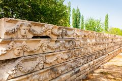 Archaeological site of Helenistic city of Aphrodisias in western Anatolia, Turkey. Stone carved panels at the Archaeological site of Helenistic city of stock images