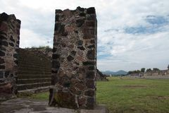 Archaeological site landscaping. Famous and majestuous Mexican archaeological site; sun pyramid during Mexico`s rainy season, green grass and flowers Stock Images