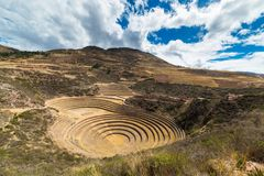 The archaeological site at Moray, travel destination in Cusco region and the Sacred Valley, Peru. Majestic concentric terraces, su Royalty Free Stock Photos