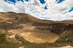 The archaeological site at Moray, travel destination in Cusco region and the Sacred Valley, Peru. Majestic concentric terraces, su. Pposed Inca`s food farming Stock Photography