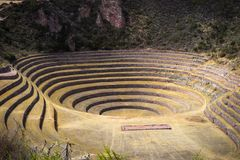 The archaeological site at Moray, travel destination in Cusco region and the Sacred Valley, Peru. Majestic concentric terraces, su. Pposed Inca`s food farming Royalty Free Stock Photography